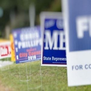 Campaign lawn signs blurred
